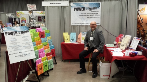 Photo of Bill Simon's booth at a conference